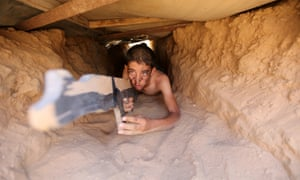 A Palestinian crawls through a tunnel during a military-style exercise at a summer camp organised by the Islamic Jihad Movement in Khan Younis, Gaza Strip.