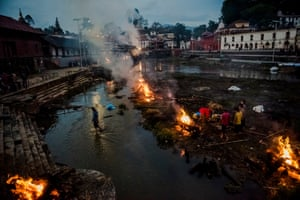 General News, third prize, stories - Daniel Berehulak - The aftermath of the 25 April 7.8 magnitude earthquake in Nepal: Flames rise from burning funeral pyres during the cremation of earthquake victims at the Pashupatinath Temple on the banks of Bagmati river