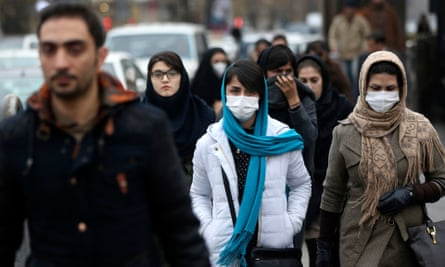 Iranian women wear masks for protection against air pollution as they make their way on a street in northern Tehran, Iran, Sunday, Dec. 20, 2015