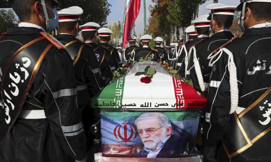 Military personnel stand near the flag-draped coffin of Mohsen Fakhrizadeh during a funeral ceremony on Monday.