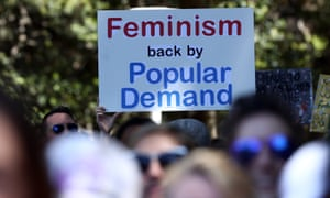 Women protestors march in a rally against US President Donald Trump following his inauguration, in Sydney on January 21, 2017.