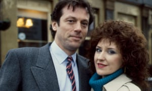 Leslie Grantham as Den Watts and Anita Dobson as his wife, Angie, outside their pub, the Queen Vic, in EastEnders, 1985.