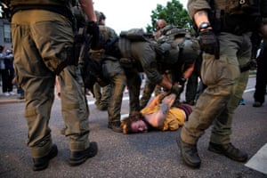 A man is detained during a protest against the fatal injury inflicted by Minneapolis police on African-American man George Floyd, in Denver, Colorado, U.S. May 28, 2020. Picture taken May 28, 2020.