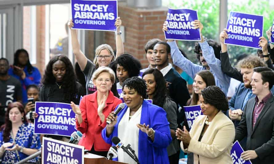 Stacey Abrams faces Georgia secretary of state Brian Kemp in the governor's race. Kemp had held back at least 53,000 voter registration applications under the 'exact match' law.