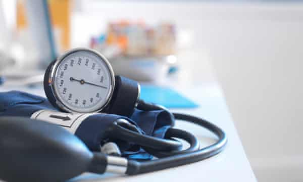 Health Screening, A stethoscope on a patients blood results after a a consultation