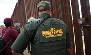 A border patrol agent on the US-Mexico border on 13 October.