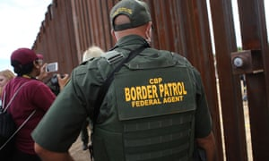 A US border patrol agent keeps watch  on the US-Mexico border