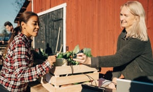 A customer pays with a card at a market in Sweden