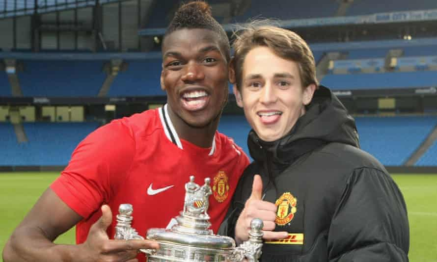 Paul Pogba and Adnan Januzaj celebrate of Manchester United winning the Manchester Senior Cup in 2012