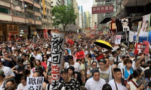 Hundreds of thousands of protesters marched through Hong Kong on Sunday.