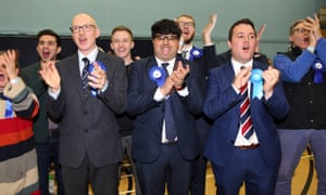 Conservative supporters celebrate victory for their candidate for Bishop Auckland, Dehenna Davison, and their Sedgefield candidate, Paul Howell, at the vote count in Spennymoor, County Durham.