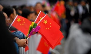 people wave chinese flags