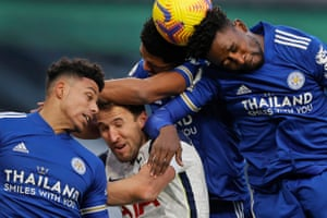 Harry Kane gets crowded out by Leicester defenders James Justin, Wesley Fofana and Wilfred Ndidi
