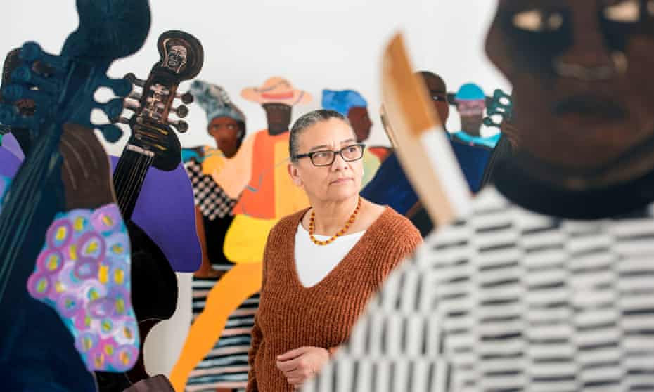 Lubaina Himid among the cutouts of slaves that form her 2004 piece Naming the Money, at Spike Island contemporary art centre in Bristol.