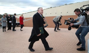 The Treasurer Joe Hockey walks to the front of Parliament ready to greet the media on the morning of the budget. Upgraded security prevented the more traditional use of the ministerial entrance of Parliament House.