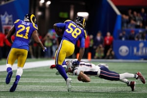 Rams inside linebacker Cory Littleton is tackled by New England Patriots wide receiver Julian Edelman