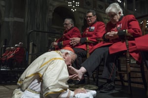 Vincent Nichols, archbishop of Westminster, washes the feet of Chelsea Pensioners at Westminster Cathedral, London