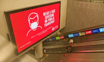 An electronic sign in London informing people that face coverings are now compulsory on public transport in England.