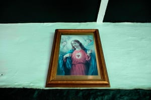 A picture of Jesus above the fireplace.