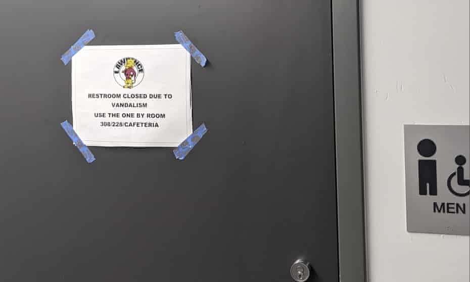 A sign on a closed restroom at Lawrence high school informs students of the vandalism that has been attributed to the viral 'devious licks' challenge on TikTok.