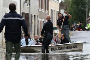 Souppes-sur-Loing, south-east of Paris Rescuers evacuate residents in a dinghy