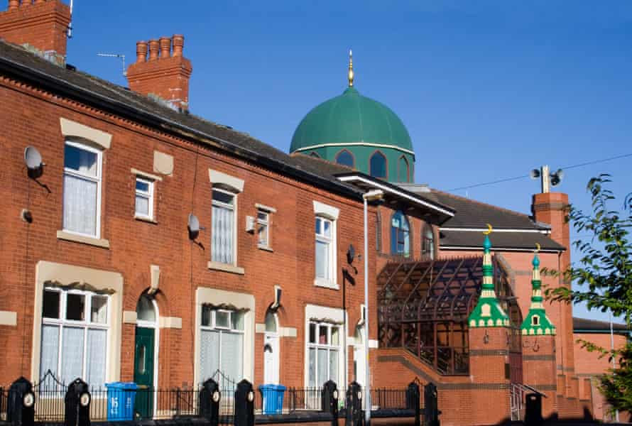 A mosque is seen above terraced houses in Greater Manchester.