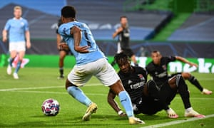 Manchester City's Raheem Sterling gets the better of Lyon's goalscorer Maxwel Cornet.