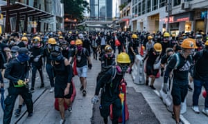 Protesters set up barricades in the Wan Chai district, one of several areas hit by violence in Hong Kong on Sunday.