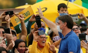 Brazil's President Jair Bolsonaro greets supporters during a protest against the President of the Chamber of Deputies Rodrigo Maia, Brazilian Supreme Court, quarantine and social distancing measures, amid the coronavirus disease outbreak, in Brasilia, Brazil May 17, 2020.