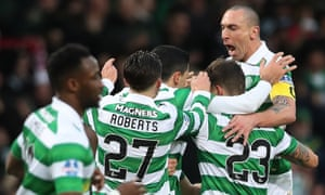 Rogic is congratulated by team mates after scoring the opener.