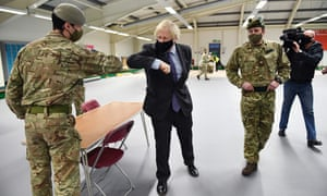Boris Johnson meets troops as they set up a vaccination centre in the Castlemilk district in Glasgow.