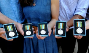 NHS staff display the medals they are planning to hand back.