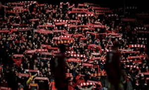 Liverpool fans hold their scarves aloft before the home game against Southampton on 1 February.