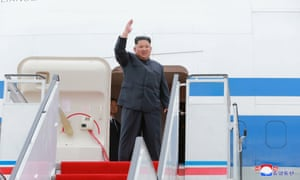 North Korea's leader Kim Jong-un waves before departing Pyongyang to Singapore