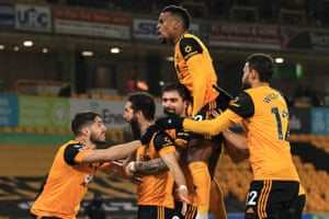 Joao Moutinho of Wolves (second left) celebrates scoring their second goal with his teammates.