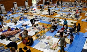 Evacuees at a school being used as a evacuation centre in Mabi, Okayama prefecture.