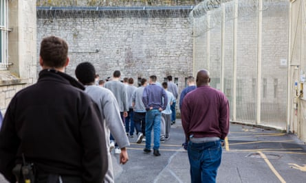 A picture of young offenders moving around a prison