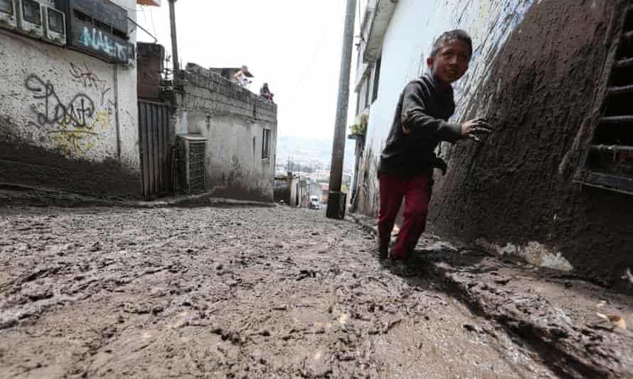 Male walking through mud covered street