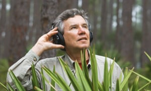 Dr Bernie Krause recording in the field. Photograph: Tim Chapman.