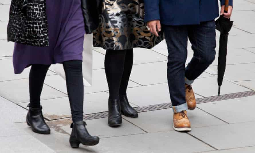 Close up of feet /shoes of two women and one man