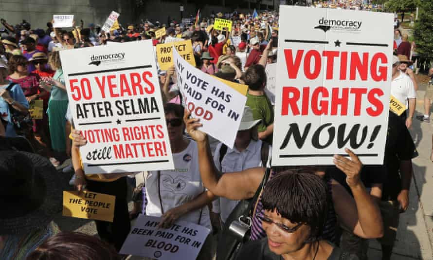 Demonstrators march through the streets of Winston-Salem, N.C., Monday, July 13, 2015, after the beginning of a federal voting rights trial challenging a 2013 state law. Election law experts say the case could determine how far Southern states can change voting rules after the nation's highest court struck down a portion of the federal Voting Rights Act just weeks before the North Carolina law was passed. (AP Photo/Chuck Burton)