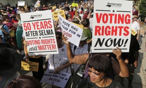 Demonstrators march through the streets of Winston-Salem, North Carolina, last Monday after the beginning of a federal voting rights trial challenging a 2013 state law.