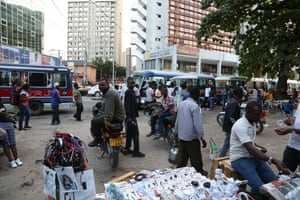Street vendors and taxi-men in Tanzania's economic capital Dar es Salaam scratch out a living in a land where two thirds live on less than $1.25 a day, despite billions of dollars in western aid, and aided by crippling corruption.