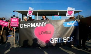 People gather during a rally for 'good German Greek cooperation' in front of the Chancellery in Berlin March 23, 2015. Greek Prime Minister Alexis Tsipras will make his first official visit to Germany and is due to meet with German Chancellor Angela Merkel later on Monday. REUTERS/Hannibal Hanschke