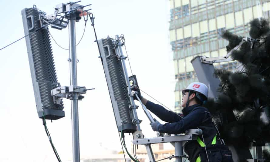 A KT technician checks an antenna for the 5G mobile network service in Seoul.