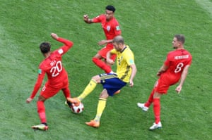 Ola Toivonen of Sweden is crowded out by England players .. The early stages of the match are cagey.