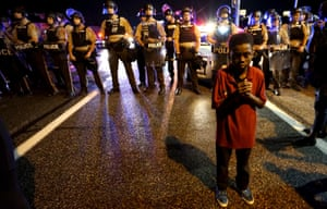 Amarion Allen, 11, stands in front of a police line shortly before the shooting