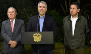 Colombian president Ivan Duque (C) with defence Minister Guillermo Botero (L) and attorney general Nestor Humberto Martinez (R), announcing the death of Farc dissident Walter Patricio Arizala, aka Guacho.