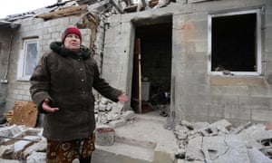 Valentina, a 73-years-old resident of Avdiivka, stands outside her home damaged during the recent shelling.