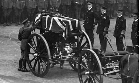 King George V placing a wreath on the coffin of the Unknown Warrior at the Cenotaph on Armistice Day 1920.